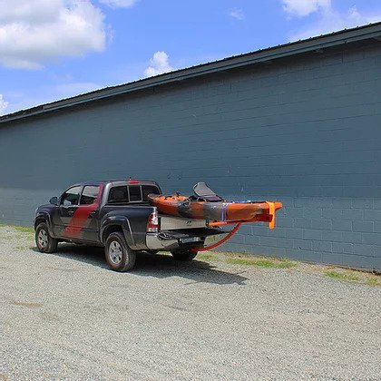 DECKED T-BONE bed extender with kayak on truck rear