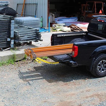 Hd Boonedox T-Bone Bed Extender with cargo in the truck rear
